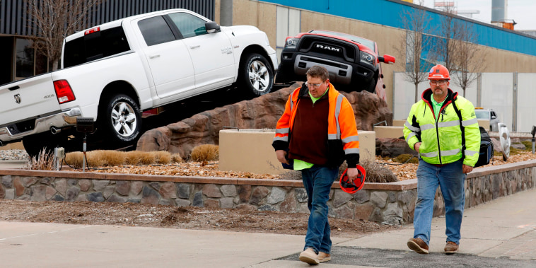 Workers leave FCA Chrysler Warren Truck Assembly after the Detroit three automakers have agreed to UAW demands to shut down all North America plants as a precaution against coronavirus on March 18, 2020 in Detroit.