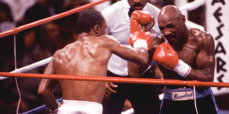 Sugar Ray Leonard, left, battles Marvelous Marvin Hagler, right, during a middleweight bout at Caesars Palace in Las Vegas on April 6, 1987. Leonard won a 12-round decision.
