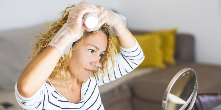 Woman dying her hair at home
