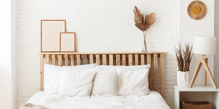 Stylish White bedroom with a brown headboard
