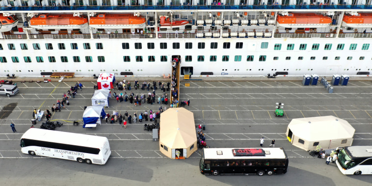 Image: Passengers disembark from the Princess Cruises Grand Princess as it sits docked in the Port of Oakland