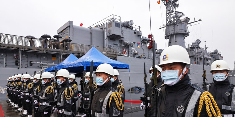 Image: Taiwan Navy personnel guard the Lan Yang (FFG-935) frigate in Keelung, Taiwan.