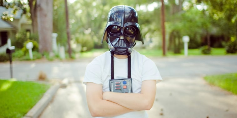 Kid wearing a Darth Vader Mask outside