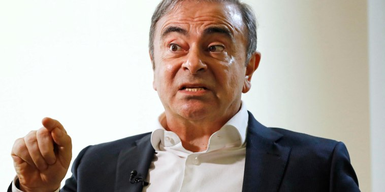Image: Former Nissan Chairman Carlos Ghosn speaks to Japanese media during an interview in Beirut, Lebanon