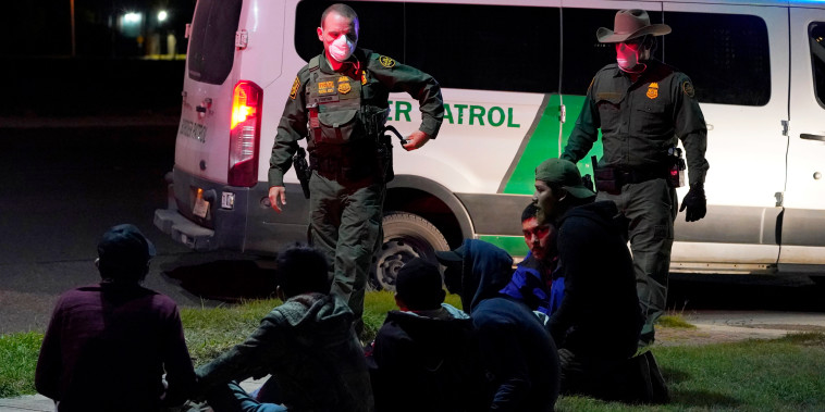IMAGE: Customs and Border Protection agents take people into custody people in Hidalgo, Texas.