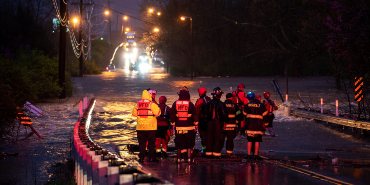 Emergency personnel stage for a call of people stranded in the water on Antioch Pike in Nashville, Tenn., on March 28, 2021.
