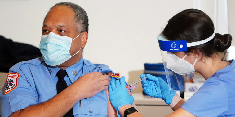 A worker for the New York City Fire Department Bureau of Emergency Medical Services receives a Moderna Covid-19 vaccination on Dec. 23, 2020.