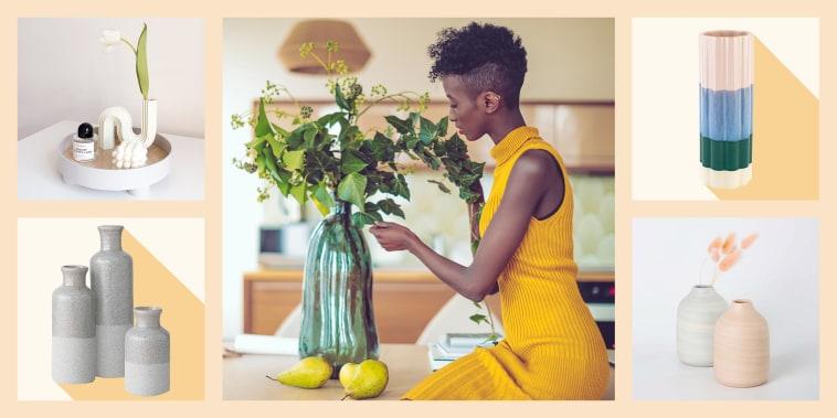 Illustration of a Woman wearing a yellow dress, sitting in her kitchen arranging flowers in a big blue vase, the RenoVois Small Bud Vase, Summer & Rose Ceramic Flower Vase, Sullivans Small Vase Set and Ceramic Snake Curve Shape Echo Vase
