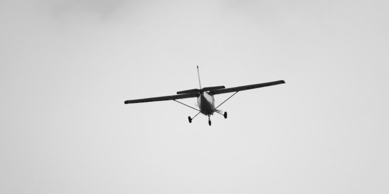 small plane taking off from the airport