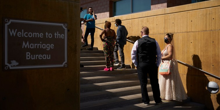 Couples wait in line for marriage licenses at the Marriage License Bureau, Friday, April 2, 2021, in Las Vegas. The bureau was seeing busier than normal traffic ahead of 4/3/21, a popular day to get married in Las Vegas.