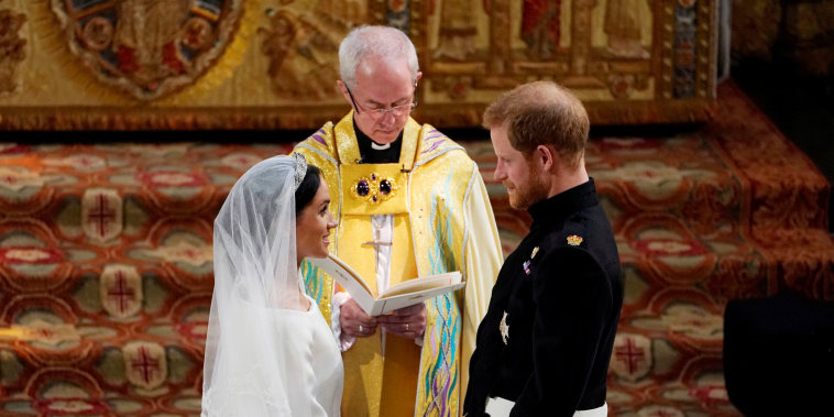Image: Prince Harry and Meghan Markle exchange vows in St George's Chapel at Windsor Castle during their wedding service, conducted by the Archbishop of Canterbury Justin Welby in Windsor
