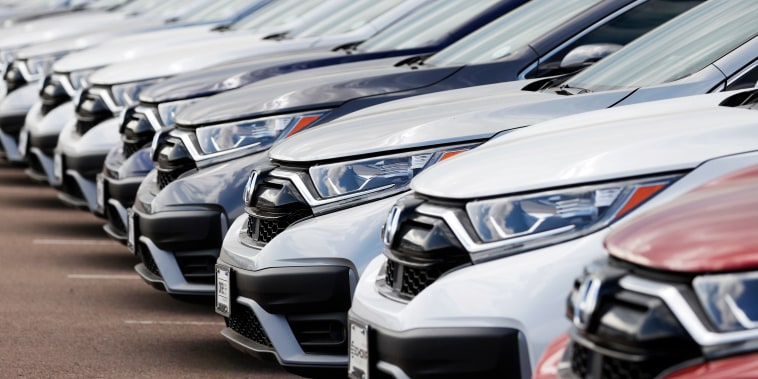 A long row of unsold 2020 CR-V sports-utility vehicles sits at a Honda dealership Sunday, July 19, 2020, in Highlands Ranch, Colo.