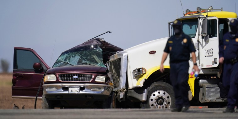 Image: Law enforcement officers work at the scene of a deadly crash in Holtville, Calif.