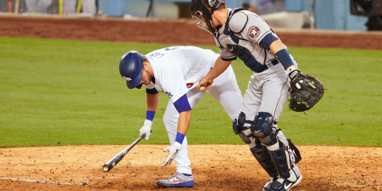 Houston Astros catcher Dustin Garneau tags Los Angeles Dodgers designated hitter Gavin Lux after he struck out to end a MLB game on Sept. 12, 2020, at Dodger Stadium in Los Angeles.