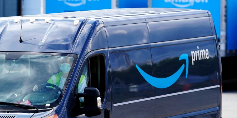 An Amazon Prime delivery van departs a warehouse location in Dedham, Mass. on Octrober 1, 2020.