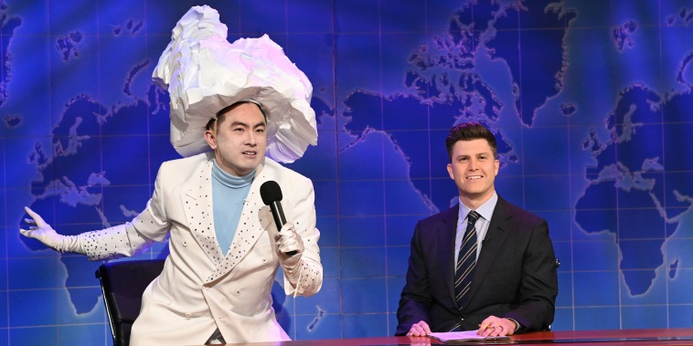 Bowen Yang as 'The Iceberg That Sank The Titanic' and anchor Colin Jost during Weekend Update on Saturday, April 10, 2021.