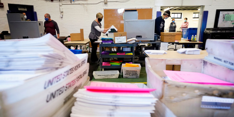 Chester County election workers scan mail-in and absentee ballots for the 2020 general election on Wednesday, Nov. 4, 2020, in West Chester, Pa.