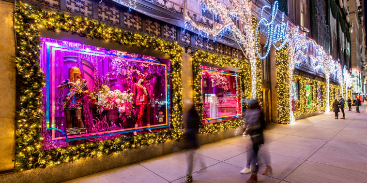 Image: Visitors look at Christmas window displays at Saks Fifth Avenue on Dec. 1, 2020 in New York City.