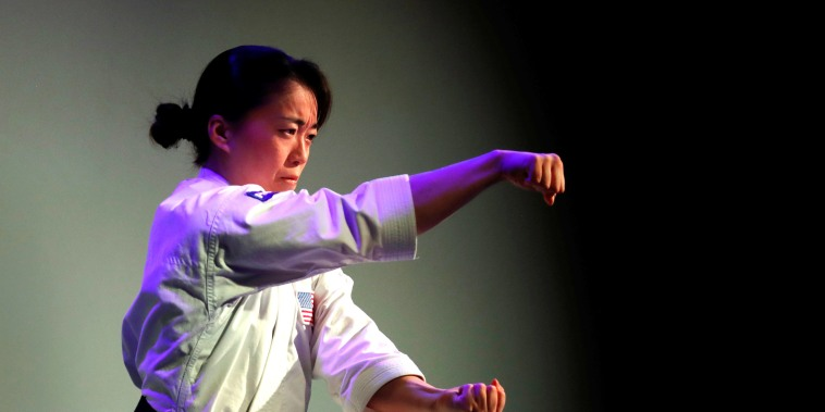 Sakura Kokumai, an Olympic athlete and member of Team Panasonic, performs karate moves at a Panasonic news conference during the 2020 CES in Las Vegas