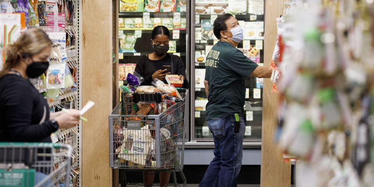 Customers and employees wear protective masks inside a grocery store in West Covina, Calif., on May 29, 2020.