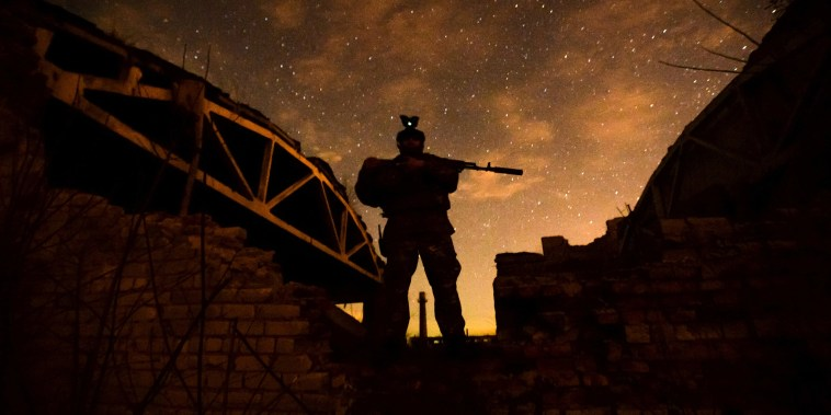 Image: A service member of the Ukrainian armed forces is seen at fighting positions in Donetsk region