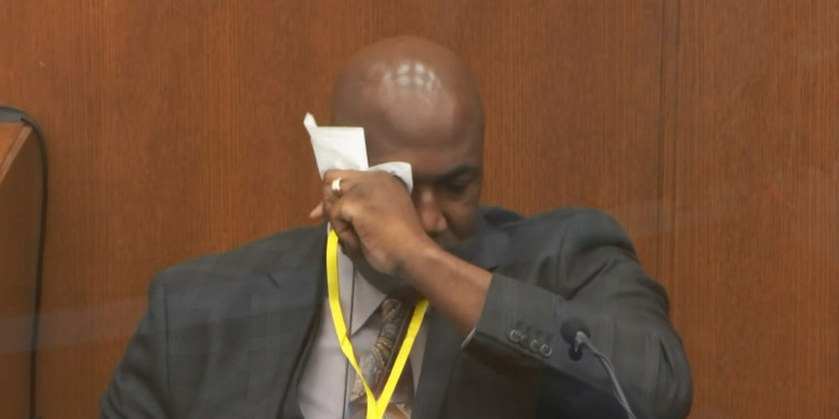 Philonise Floyd, George Floyd's brother, wipes his eyes as he takes the stand in the Hennepin County Courthouse in Minneapolis on April 12, 2021.