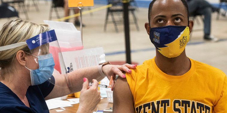 Image: Kent State University student Marz Anderson gets his Johnson & Johnson Covid19 vaccination from Kent State nurse Beth Krul in Kent
