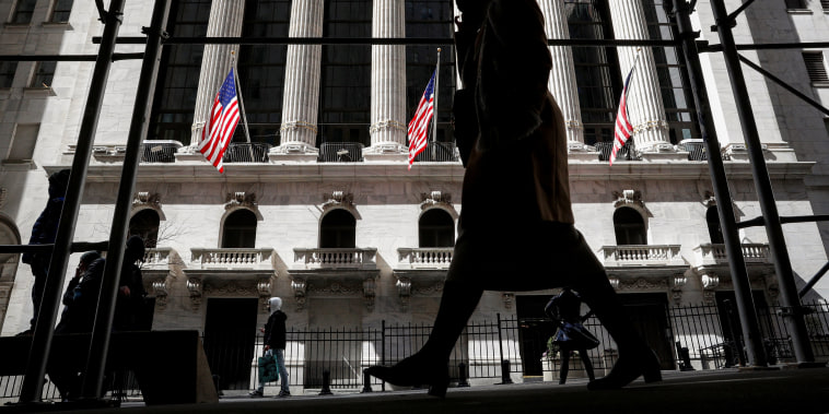 Image: People are seen outside the NYSE in New York