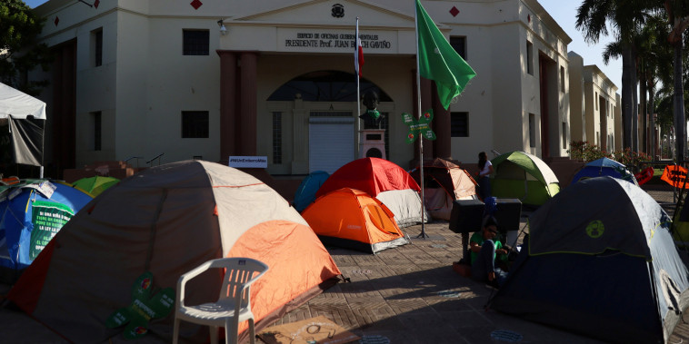 Tents of abortion rights activists are set up in front of the National Palace during a protest to pressure parliament to end the total ban on abortion in Santo Domingo, Dominican Republic, on March 18, 2021.
