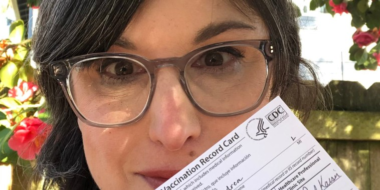 Writer Andi Zeisler displays her Covid-19 vaccination card after getting the Johnson & Johnson shot.