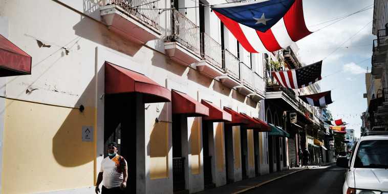 Image: People walk through Old San Juan on March 21, 2021 in San Juan, Puerto Rico.