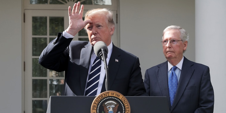 President Donald Trump and Senate Majority Leader Mitch McConnell talk to reporters in the Rose Garden of the White House on Oct. 16, 2017.