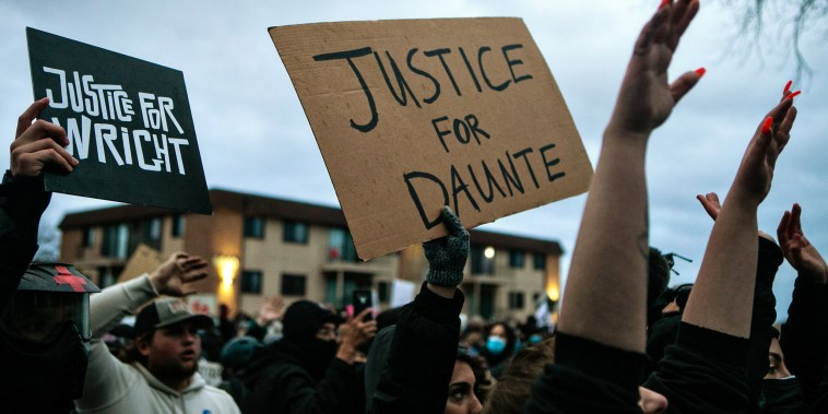 Image: Protesters gather outside the Brooklyn Center Police Department calling for justice for Daunte Wright before curfew on April 14, 2021 in Brooklyn Center, Minn