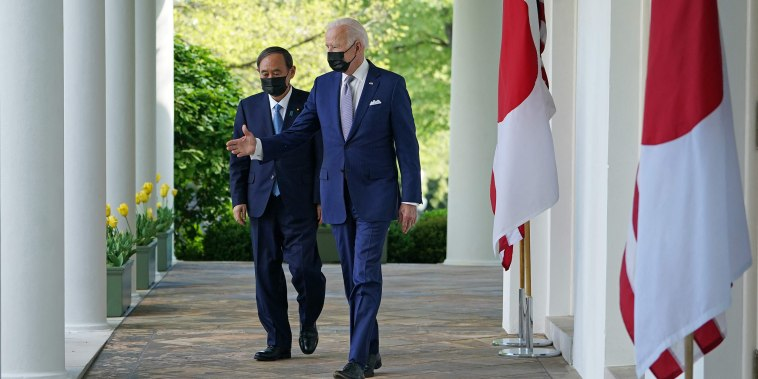 Image: President Joe Biden and Japan's Prime Minister Yoshihide Suga walk through the Colonnade for a joint press conference in the Rose Garden of the White House on April 16, 2021.