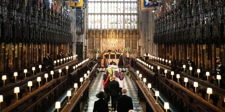 Image: The coffin of Britain's Prince Philip, husband of Queen Elizabeth, who died at the age of 99, is carried into The Quire during his funeral service at St George's Chapel, in Windsor