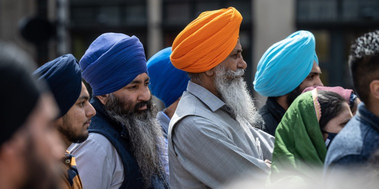 Members of the Sikh community gather and listen during a vigil at Monument Circle on April 18, 2021, in Indianapolis.