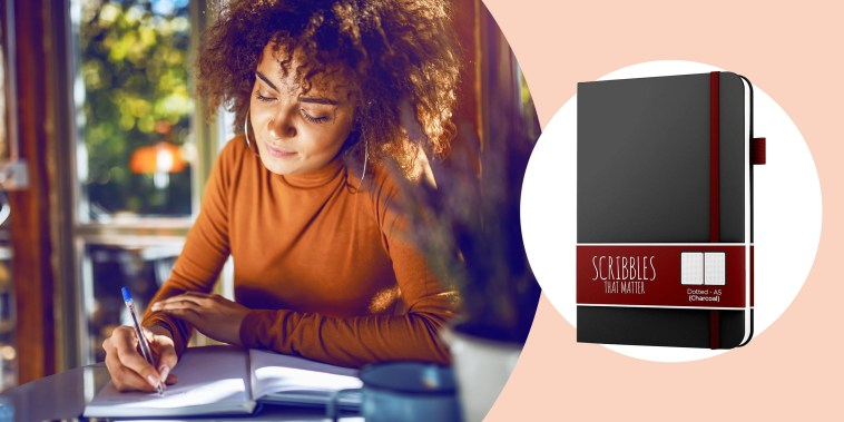 Illustration of a Woman writing in her journal at a desk and the A5 Dotted Journal by Scribbles That Matter  in black. See the best bullet journal notebooks and planners of 2021. Learn how to bullet journal and how it can help organize your life and impro