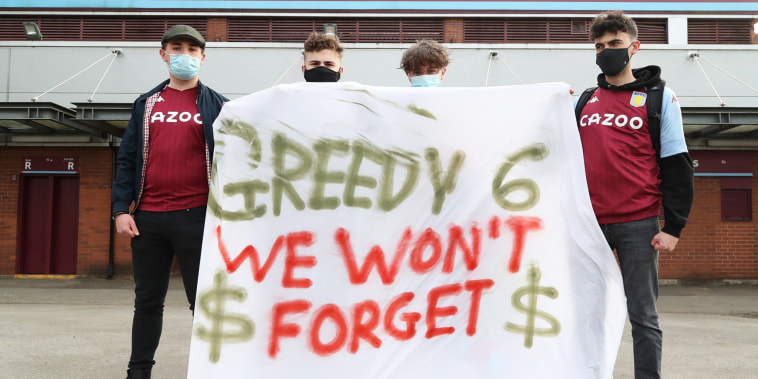 Fans display a banner reacting to the collapse of the planned creation of a European Super League in central England on April 21, 2021.