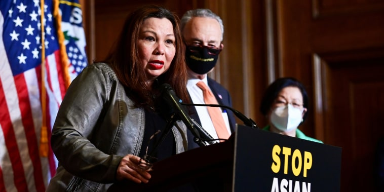 Sen. Tammy Duckworth, D-Ill., speaks alongside fellow Democrats after the Senate passed the Covid-19 Hate Crimes Act on Capitol Hill on April 22, 2021.