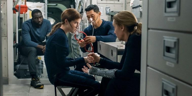 "Shamier Anderson as Michael Adams, Anna Kendrick as Zoe Levenson, Daniel Dae Kim as David Kim, and Toni Collette as Marina Barnett in \""Stowaway\"" on Netflix."