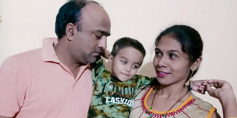 Image: Praveen Dupare with his five-year-old son and wife, Khushabu.