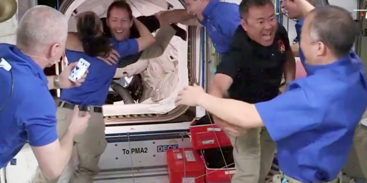 Image: Crew 2 is welcomed by Crew 1 aboard the International Space Station