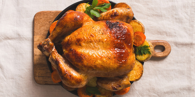 Fall thanksgiving table with roasting chicken or turkey on light tablecloth