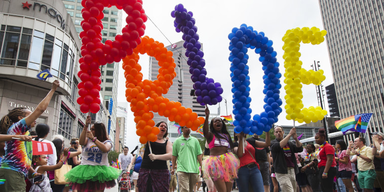 Revelers march through downtown Cincinnati during the Cincinnati Pride parade, Saturday, June 27, 2015. On Friday, the U.S. Supreme Court ruled that same-sex couples have the right to marry nationwide.