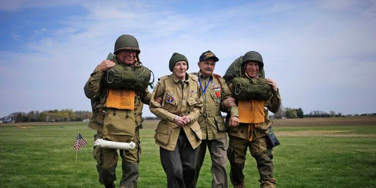 "World War II paratrooper veterans Jim \""Pee Wee\"" Martin and Dan McBride walk across the drop zone at Pee Wee's Jump Fest in Xenia, Ohio."