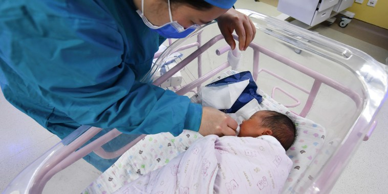 Image: A newborn baby being cared for in the ward of the hospital neonatal care center in Fuyang, China