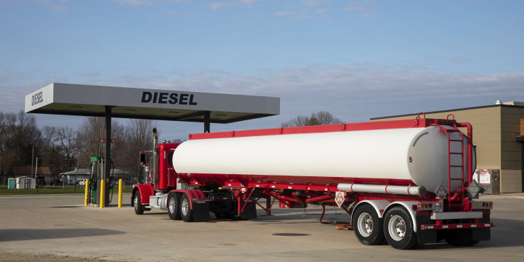 A tanker truck sits parked outside a Phillips 66 gas station during a fuel delivery Princeton, Ill., on April 1, 2020.