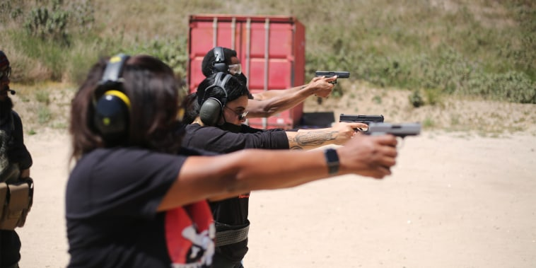 Students partake in Redstone Firearms' beginner handgun course at Angeles Shooting Ranges in Lake View Terrace, Calif., on April 18, 2021.