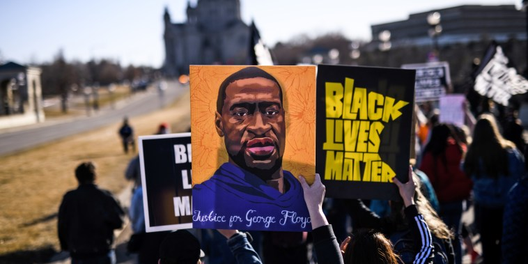 People march near the Minnesota State Capitol to honor George Floyd on March 19, 2021 in St Paul, Minn.