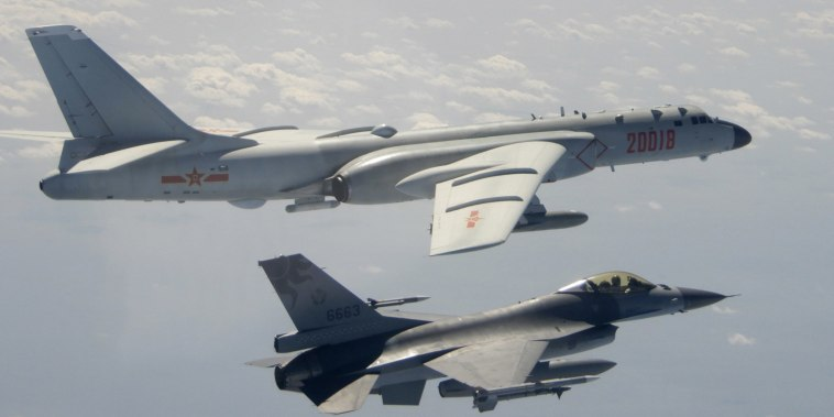 Image: A Taiwanese Air Force F-16 in foreground flies on the flank of a Chinese People's Liberation Army Air Force H-6 bomber as it passes near Taiwan,
